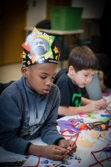 Two boys at MLK Day crafts table