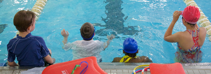 aquatic students in swimming lane