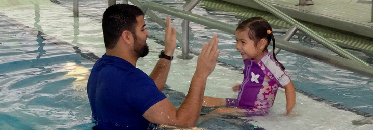 aquatics teacher with child
