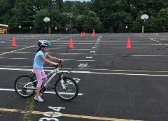 girl learning to ride bicycle