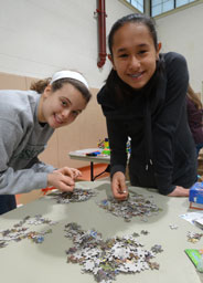 girls making puzzle